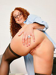 Slutty teacher in glasses Kitty Caulfield strips to black stockings