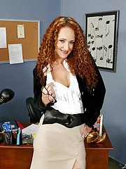 Redheaded MILF teacher Kitty Caulfield revealing big tits in the class