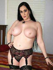 Plumper mom in fishnet stockings revealing puffy hooters and ass