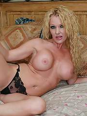 Busty mom Dani Sexton strips from jeans and black lace lingerie