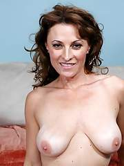Heated mom Danielle Frost denudes puffy boobs and fucks on the couch