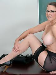 Mature teacher in stockings and sexy coed with pigtails strip together