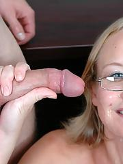 Blond coed in glasses pleasuring two cocks and gets facialized in class