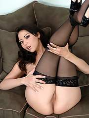 Hot asian babe posing in black lace top stocking and fingering pussy