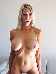 Dazzling MILF Emma Starr showing off booming tits and shaved slit