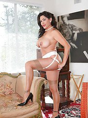 Elegant mature lady in nylon stockings brings out puffy tits