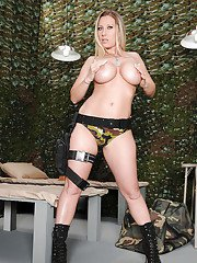 Hot mature Devon Lee strips off camouflage panties and poses with AK47