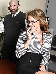 Sexy office latin MILF sharing huge dick with her big titted co-worker