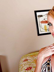 Mature slut Taylor Wane showing off huge fake tits and comely booty