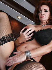 Mature MILF with big tits in stockings shows her craving pussy