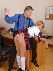 Naughty schoolgirl in a miniskirt giving her teacher a decent blowjob