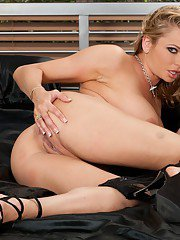 Busty MILF Briana Banks strips and demonstrates booming assets