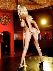 Slender MILF mom is stripping by the pole to show her hot body