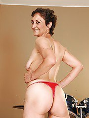 Mature lesbian with a hairy mink takes off her skirt and panties