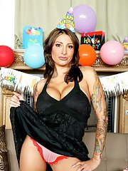 Busty MILF in panties Ricki Raxxx shows her tattooed body and hot ass