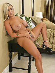 Sexy wife with huge juggs Memphis Monroe plays with her shaved cunt