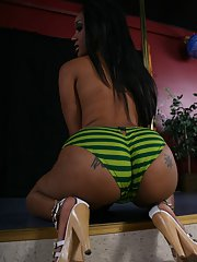 Ebony babe Kapri Styles strips by the pole and exposes her cunt