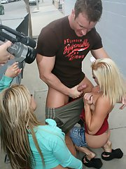 Busty babes Cayden Moore and Cali Cassidy have a gangbang in public