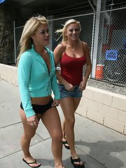 Busty Cayden Moore and Cali Cassidy in tight shorts pose in public