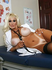 Big titted MILF in doctor uniform exposing her pussy and huge juggs