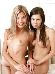Heated teen lesbians caressing tiny tits and showing cute little twats