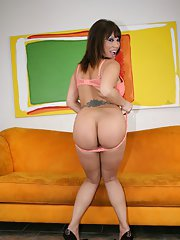 Asian MILF Ava Devine squeezing her huge juggs and showing big booty