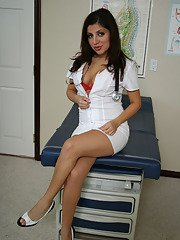 Slutty nurse Sativa Rose seductively shows and rubs her tight pussy