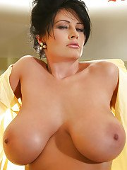 Busty hottie in stockings strips and touched her big breast