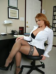 MILF babe Brooke Haven strips to her stockings and spreads her thighs