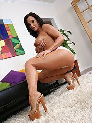 Busty MILF Lisa Ann poses on high heels and masturbates her pussy