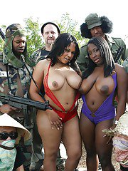 Ebony cocksuckers Kandi and Luxury getting banged in a wild groupsex