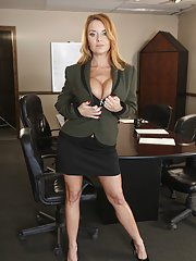 Milf babe Janet Mason spreading legs showing holes in an office