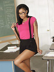 Black college babe Skin Diamond strips in the class and masturbates