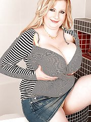 Fat blonde Anna Beck playing with her huge tits in the bathroom