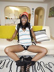 Ebony coed with big tits Envy Star shows her slender naked body