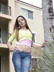 Latin babe Tarra takes off her jeans and shows her shaved pussy