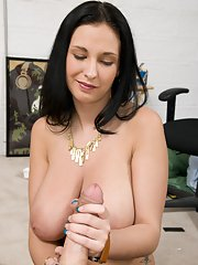 MILF babe with huge tits Bella Blaze giving a handjob and a titjob