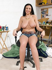 MILF babe with big tits Bella Blaze takes off panties in office