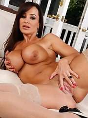MILF babe with huge tits Lisa Ann masturbating and spreading pussy