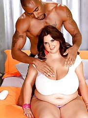 Big tits of fatty Charlie Cooper bounce during interracial fucking