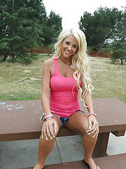 Long legged teen blonde Courtney Tyler posing outdoor in jean shorts