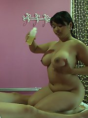 BBW asian girl gives an oily massage and rides on a hard cock