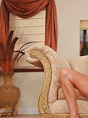 Mature lady Brenda James takes off white lace lingerie and spreads legs