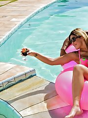 Sultry MILF in bikini Anny Lee scores a big black dick in the pool