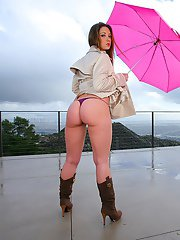 Sweet babe in suede boots Jordana posing outdoor with pink umbrella