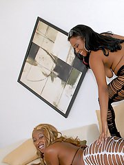 Two ebony lesbians with big tits and huge asses stripteasing