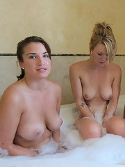 Horny lesbian girlfriends with big tits kissing each other in the bath