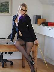 Luscious teacher in glasses Elise strips and poses in the class room