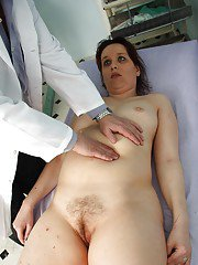 Mature gal at the Gyno spreading her hairy cunt for poking amp prodding