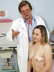 Mature at the gyno gets her hairy twat spread wide amp finger violated